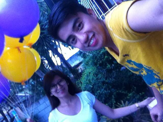 Photo op with these balloons. Purple and Yellow all the way, baby!